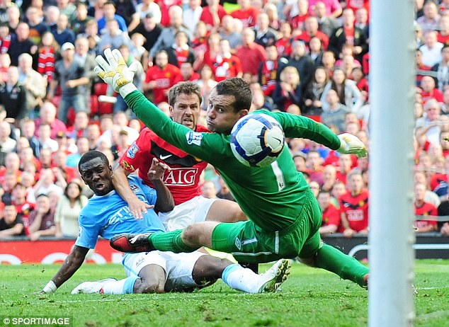 Killer instinct: Michael Owen scoring the stoppage time goal when United won the derby 4-3 in 2009