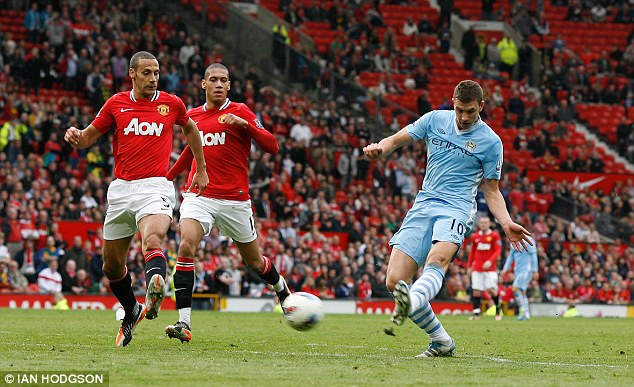Unthinkable: Edin Dzeko scoring the sixth for Manchester City's in their 6-1 win at Old Trafford
