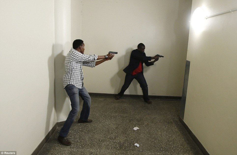 Deadly: Armed police search Westgate Shopping Centre in Nairobi for the last remaining gunmen