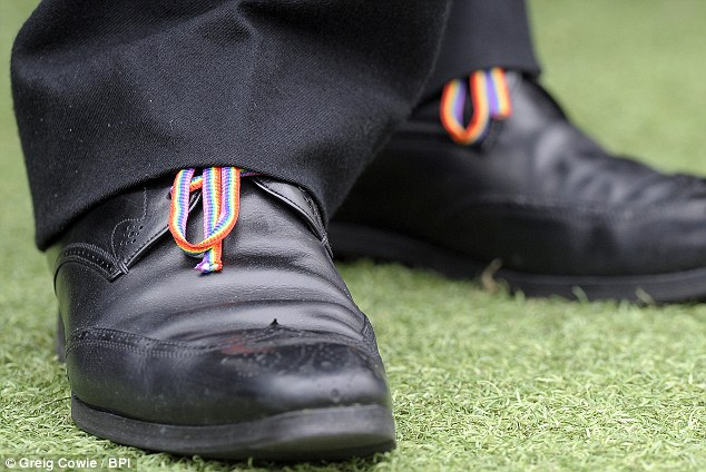 Alan Pardew manager of Newcastle United shows his support for the Stonewall campaign with Rainbow laces with his dark suit