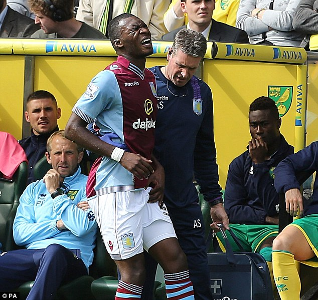 Agony: Aston Villa's Christian Benteke leaves the Carrow Raod pitch with a groin injury against Norwich