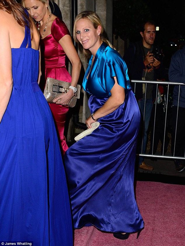 Glowing: Zara Phillips arrives for the Boodles Boxing Ball at the Grosvenor House Hotel in a flowing blue and purple dress