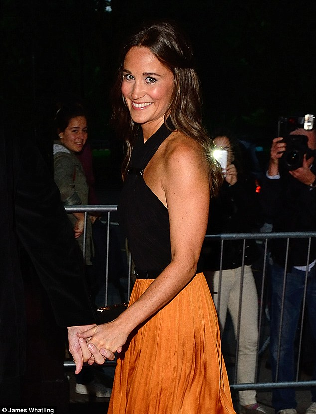 Dress to impress: Pippa looked radiant as she posed for pictures outside the Grosvenor House Hotel in London's Park Lane
