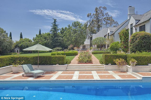 Serene: All the windows in the house look out onto the sprawling gardens and swimming pool