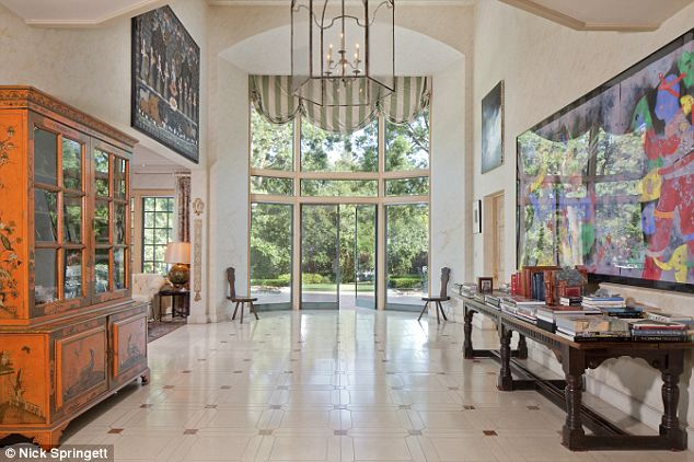 Palatial: The residence has large windows opening out to the landscaped park-like grounds