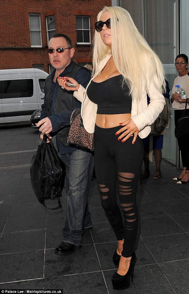 Courtney Stodden appears to have made an effort for her studio appearance, while Doug dresses down in casual shirt and jeans