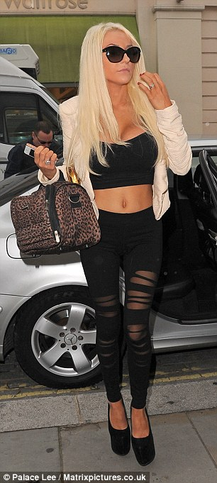 Courtney turns heads in her semi-sheer bondage style leggings and revealing cropped vest-top