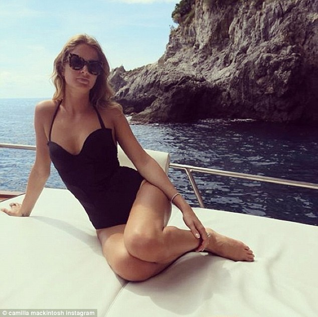 Bellissima: Millie poses in yet another bikini as she takes a romantic boat ride with Professor Green