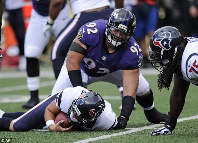 On the floor: Baltimore Ravens defensive tackle Ngata sacks Houston quarterback Matt Schaub