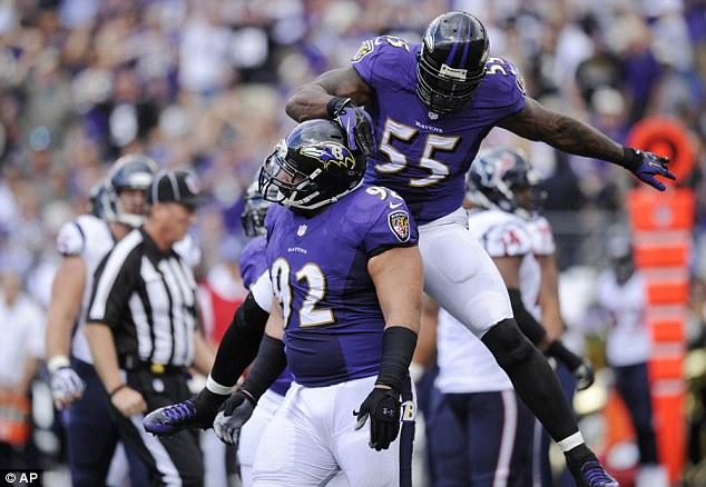 Joy: Ravens linebacker Terrell Suggs celebrates with defensive tackle Haloti Ngata during their win over Houston