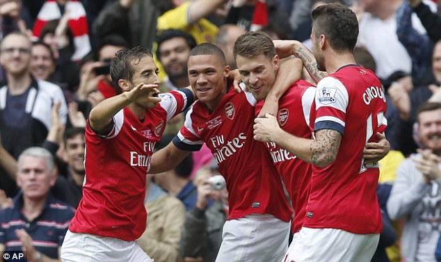 In the goals: Aaron Ramsey  celebrates with team-mates after scoring against Stoke