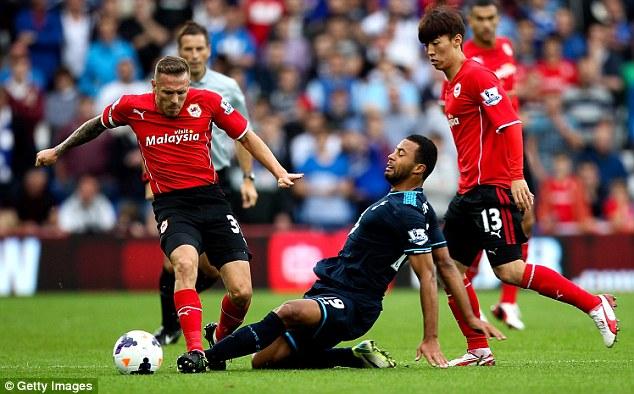 Wriggle: Craig Bellamy nicks the ball off Moussa Dembele