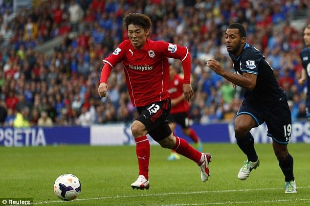 Up a notch: Kim Bo-kyung runs past Tottenham Hotspur's Moussa Dembele