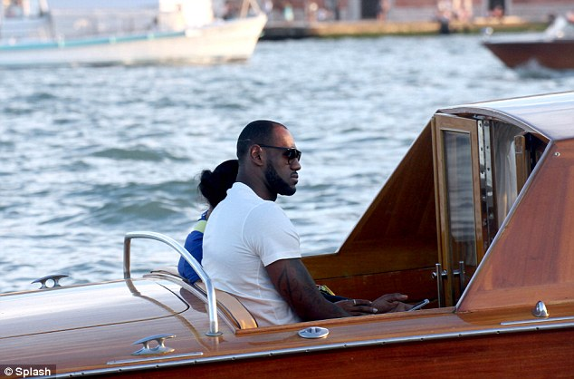 Taking it easy: They looked relaxed as they took to the sea aboard the boat as they switched location to Venice