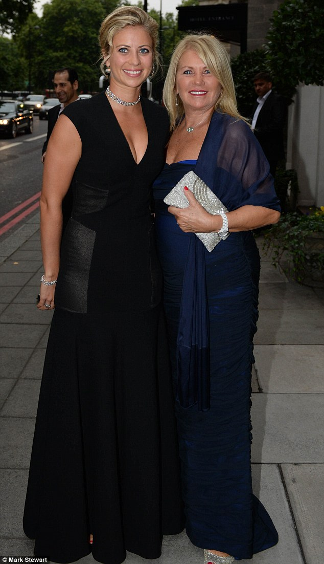 Two blondes: Holly Branson cuddled up to her mother Joan as they arrived together for the lavish bash