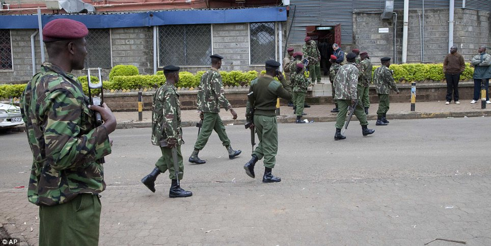 Lock-down: Kenya security personnel walk to their positions outside the shopping mall