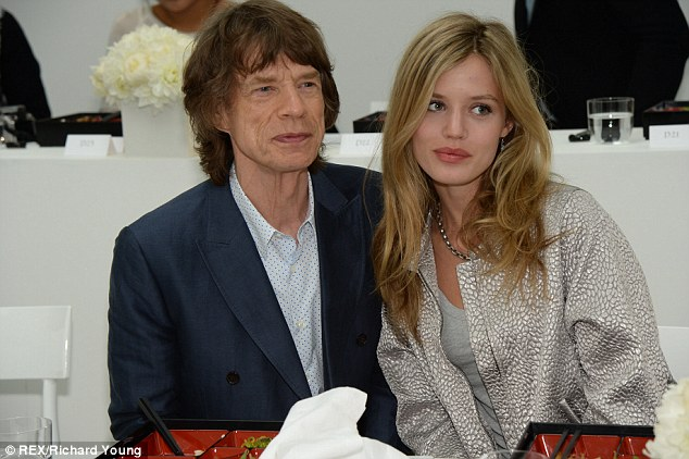 Model family: Sir Mick was pictured at London Fashion Week last weekend with his youngest daughter, model Georgia May Jagger