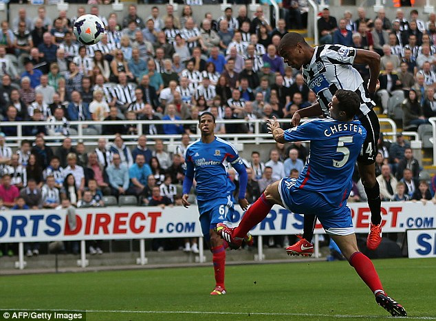 Off the mark: Frenchman Remy, on loan from QPR, heads home Newcastle's opening goal after nine minutes