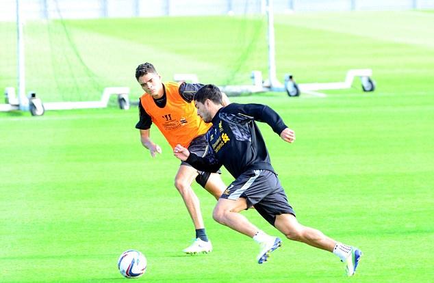 Luis Suarez and Tiago Ilori