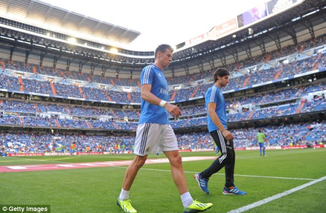 Not happy: Bale trudges off down the tunnel