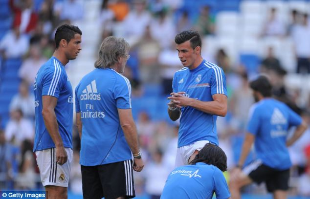 Concerned: Cristiano Ronaldo watches on as Bale describes his injury