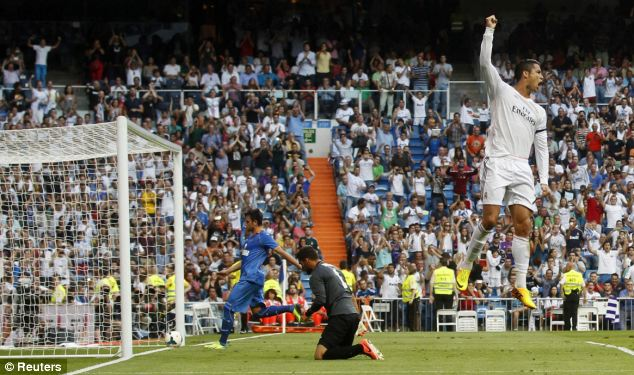 Red hot: Ronaldo celebrates scoring Madrid's winner from the penalty spot