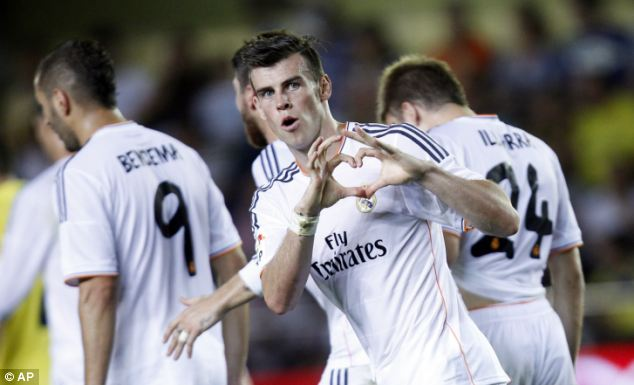 Strong start: Bale celebrates scoring against Villarreal on his debut