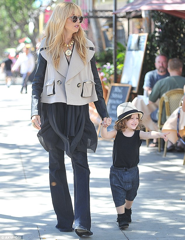 This way! Little Skyler points the way to his famous mother as the pair head out for some frozen yoghurt in West Hollywood on Sunday