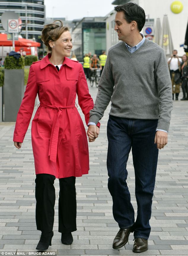 Side-by-side: Justine and Ed Miliband walk through Brighton city centre in one of several photo opportunities during the Labour conference
