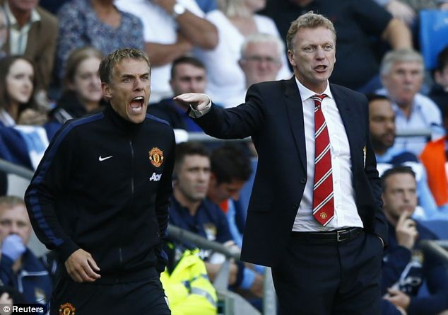 Battle cry: Giggs takes a backseat as Moyes and Phil Neville advise from the touchline