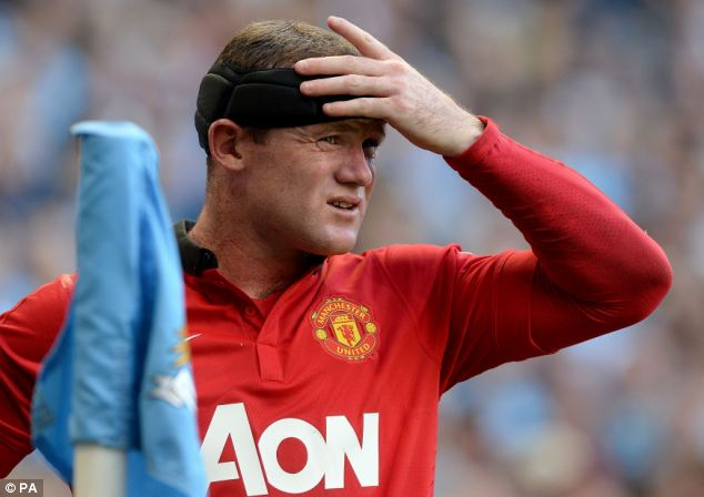 Powerless: Wayne Rooney couldn't prevent United slipping to a convincing defeat