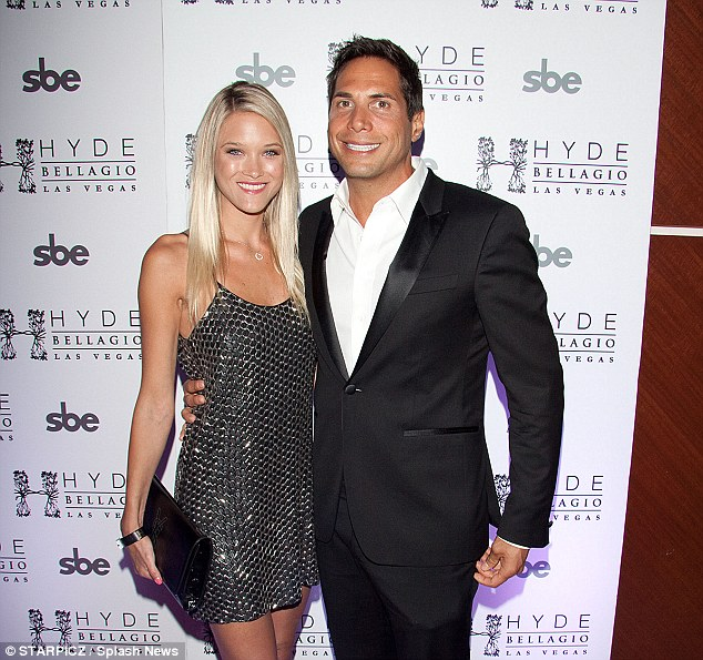 Having a bad year: Joe Francis, pictured with girlfriend Abbey Wilson, has already lost his freedom, now he's about to lose his Bel-Air home