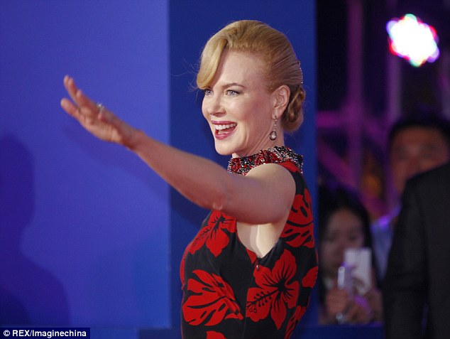 The statuesque star waves to fans at the event on Sunday