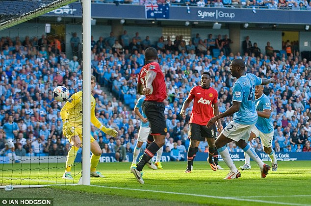 On target: Toure scores Manchester City's second goal