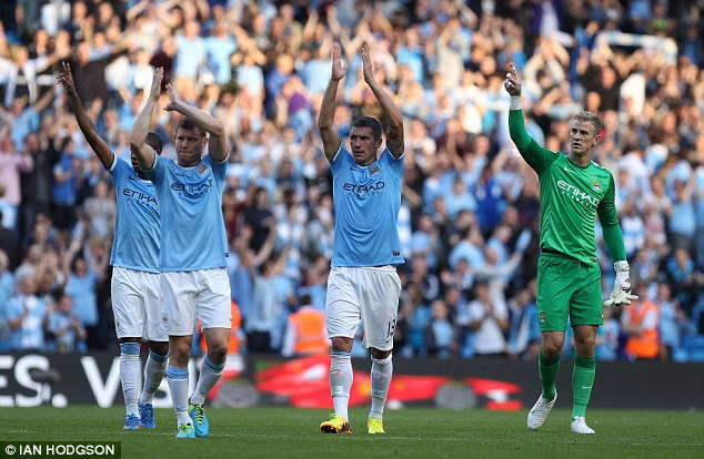Job done: City players applaud the home support