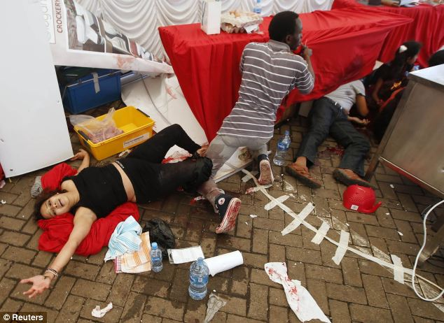 Injured people cry for help after gunmen went on a shooting spree in the Westgate shopping centre in Nairobi
