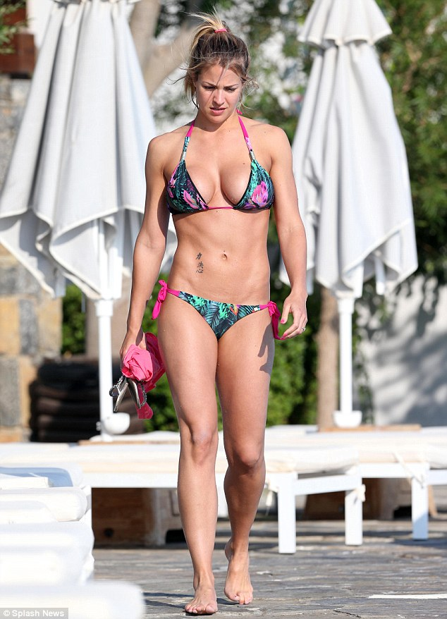 Ripped: Gemma Atkinson shows off her super toned figure in a printed bikini on holiday in the Mediterranean