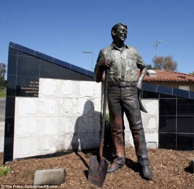 Vandalized: The life-size statue of Ronald Reagan was charred when vandals set fire to it on Thursday night