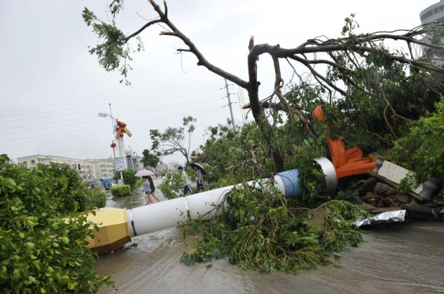 Wreckage: At least 25 people died on Monday after the typhoon south China's Guangdong Province where more than 3.56 million people in the province have been affected by Usagi, and 226,000 people were relocated