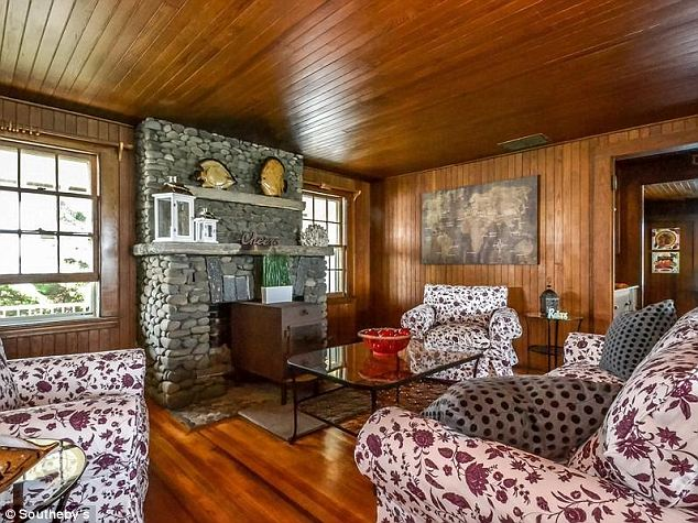 Antique: The perfectly preserved cottage was built in 1912 and features original wainscoting throughout