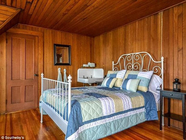 Homey: The all-wood interior gives the four-bedroom summer cottage a maritime feel that would make Captain Kidd himself feel right at home