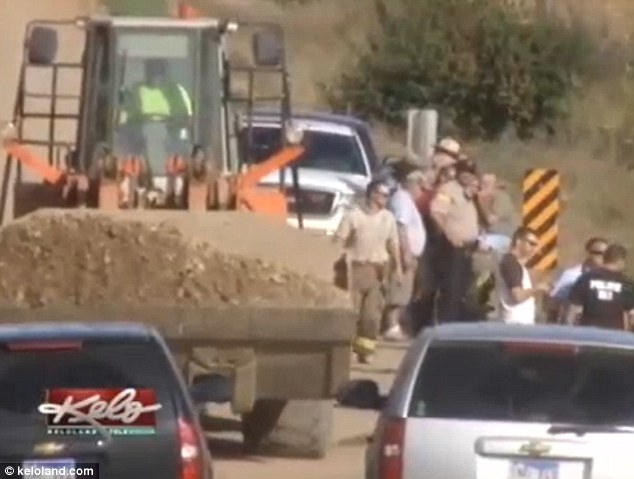 Authorities work to recover the car  from an embankment in Brule Creek, South Dakota
