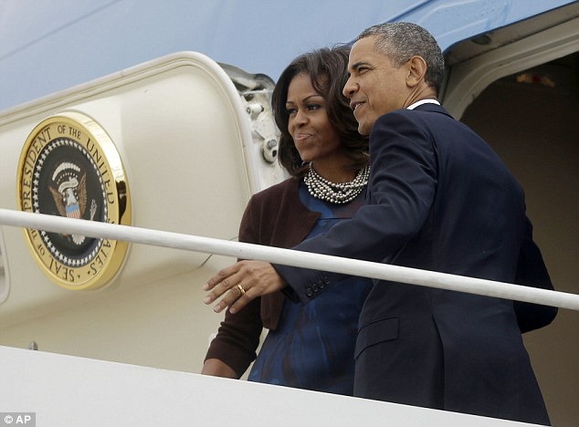 President Barack Obama and first lady Michelle Obama prepare to board Air Force One before their departure from Andrews Air Force Base Monday, Sept. 23, 2013