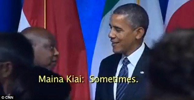 In this grab from a CNN video, U.N. official Maina Kiai (left) says 'Sometimes' when asked by President Obama whether he has stopped smoking
