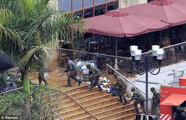 Assault: Kenyan soldiers take their position at the Westgate shopping centre, on the fourth day since militants stormed into the mall in Nairobi