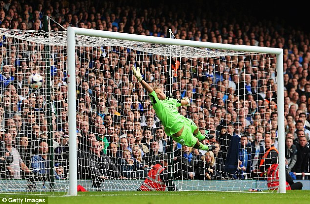 No stopping that one: Jussi Jaaskelainen is unable to stop Baines's free kick