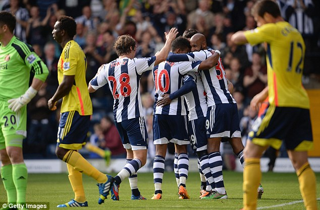 Sinking feeling: Sunderland players look dejected as former striker Stephane Sessegnon scored for West Brom