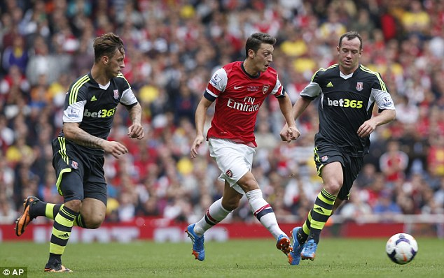 Stats not amazing: Arsenal's Mesut Ozil had three assists on Saturday - but they can be misleading