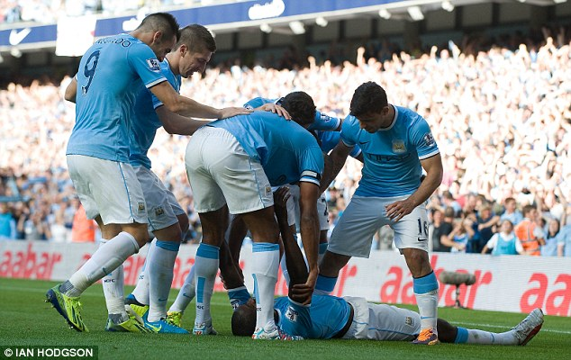 Four-midable: Yaya Toure celebrates his goal