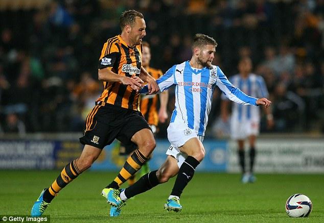 Tiger chases Terrier: David Meyler (left) fights for possession with Huddersfield's Oliver Norwood